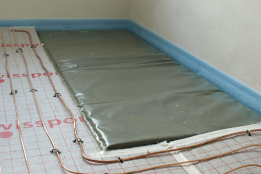 Building mat with radiation protection